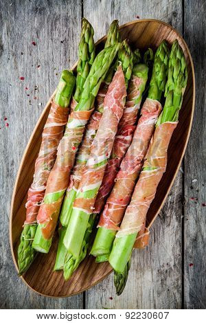 Fresh Organic Asparagus Wrapped In Parma Ham On A Bowl
