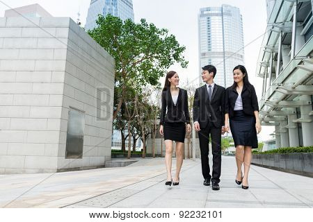 Group of business people walking along the street at outdoor in Hong Kong