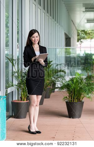 Businesswoman use of tablet at Hong Kong central district