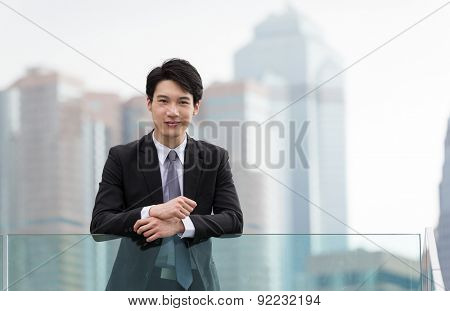 Young businessman standing at outdoor in Hong Kong central district