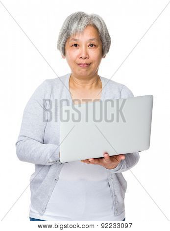 Mature woman use of notebook computer