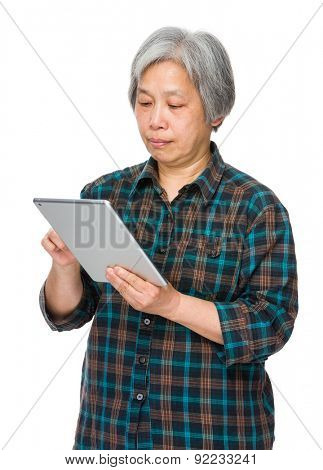 Elderly woman use of tablet pc