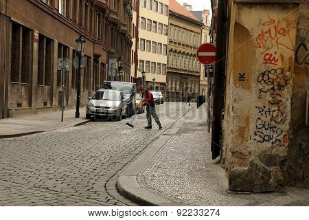 Man Sweeping the Road On The Street