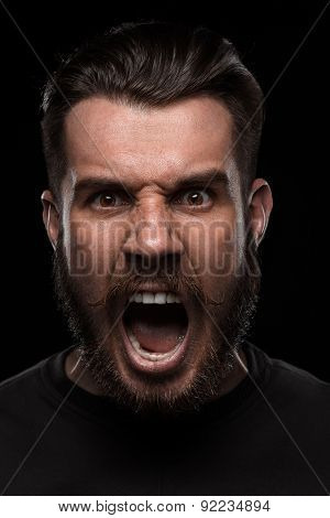 Portrait of young screaming man in studio