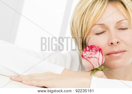 Forty years woman with rose flower