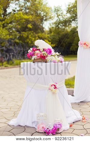 Beautiful wedding set up of table and floral composition