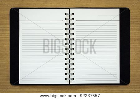 Blank Spiral Notebook On Wood Background