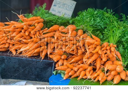 Orange Baby Carrots Piled On The Table In Local Market