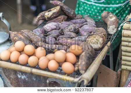 Roasted Sweet Potatoes And Eggs On Grill
