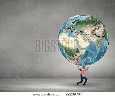 Young man lifting Earth planet above head. Elements of this image are furnished by NASA