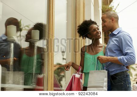 African American Couple Look Shop Window In Panama City