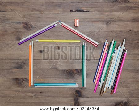 colored pencils  in shape of  house