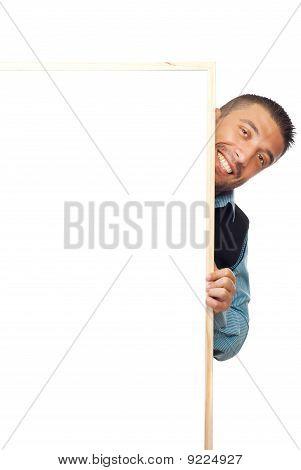 Businessman Hiding Behind Banner