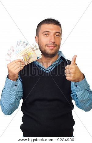 Man Holding Euro Money And Give Thumbs