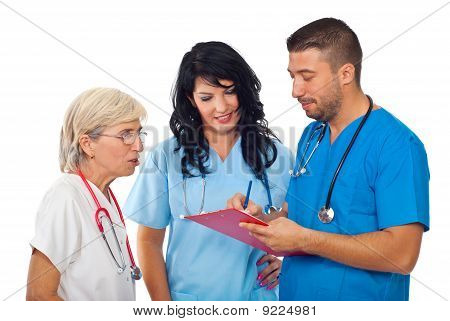 Doctors With Clipboard  Having Converation
