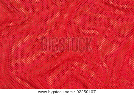 Red Crumpled Nonwoven Fabric On A Green