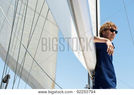 Side view of middle-aged man on yacht