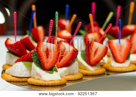 Appetizers, gourmet food canape with cheese and strawberries