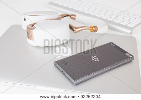 BlackBerry Leap smartphone back, Apple MacBook Pro Retina and Parrot Zik ear-flaps