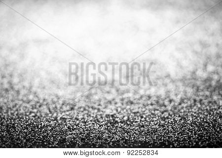 Holiday Abstract Glitter Background With Blinking Lights And Silver Defocused Texture. White Glitter