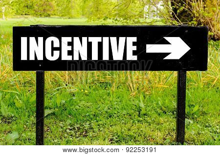 Incentive Written On Directional Black Metal Sign