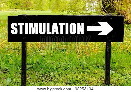 Stimulation Written On Directional Black Metal Sign