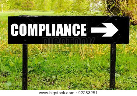 Compliance Written On Directional Black Metal Sign