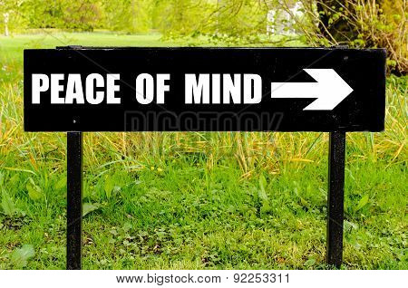 Peace Of Mind Written On Directional Black Metal Sign