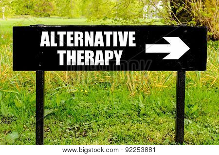 Alternative Therapy On Directional Black Metal Sign