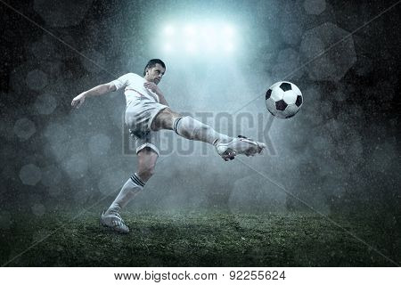 Soccer player with ball in action outdoors