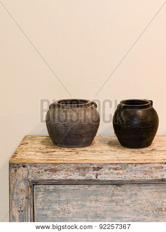 Two Empty Pots On Wooden Old-looking Cupboard