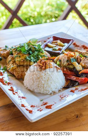 Traditional Balinese cuisine. Vegetable stir-fry fish and rice.