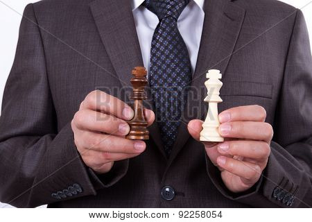 Businessman Showing Chess Piece Kings