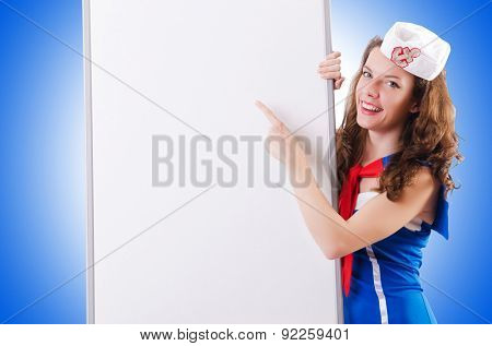 Young woman sailor in marine concept