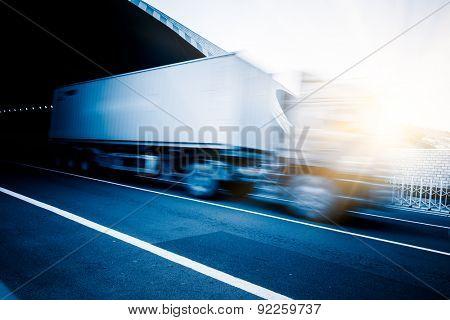 motion blurred truck on a highway/motorway/speedway
