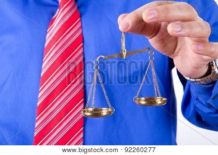 Businessman Shows Scales