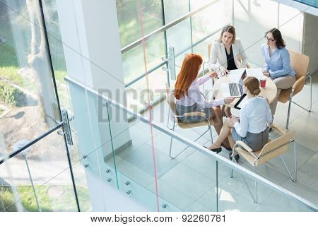 High angle view of businesswomen discussing at table in office