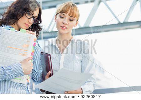 Businesswomen reading document in office
