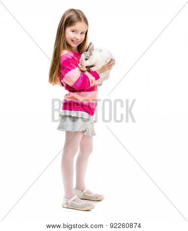 little smiling girl in a crimson sweater  with baby rabbit over white background