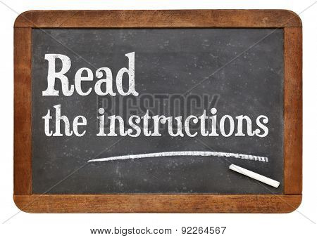 Read the instructions advice on a vintage slate blackboard