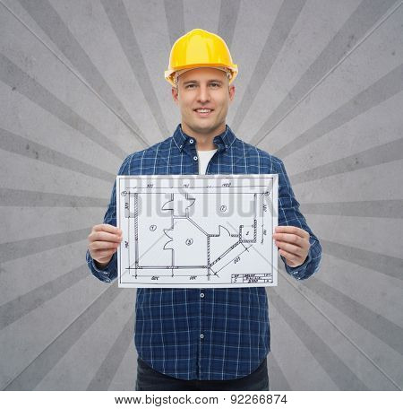 repair, construction, building, people and maintenance concept - smiling male builder or manual worker in helmet showing blueprint over gray burst rays background