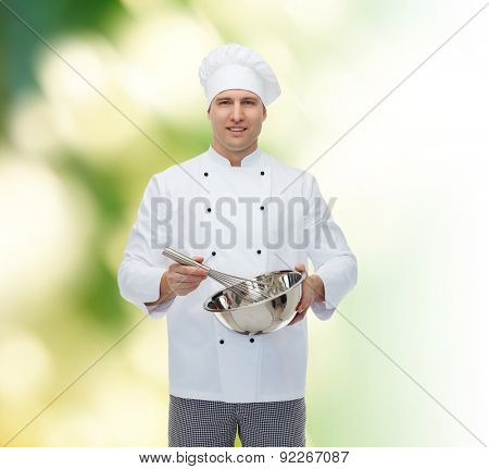 cooking, profession and people concept - happy male chef cook holding bowl and whipping something with whisk over green background