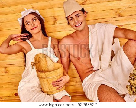 Couple man and woman  in hat  relaxing at sauna.