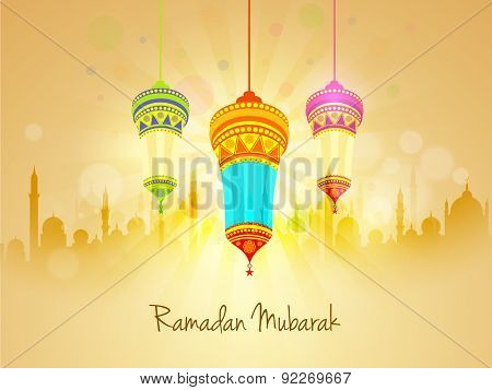 Beautiful floral design decorated traditional hanging lanterns on mosque silhouetted shiny rays background for Islamic holy month of prayers, Ramadan Kareem celebration.