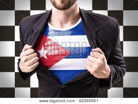 Businessman stretching suit with Cuba Flag on checkered background
