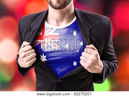 Businessman stretching suit with Australia Flag on bokeh background