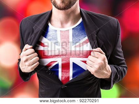 Businessman stretching suit with United Kingdom Flag on bokeh background