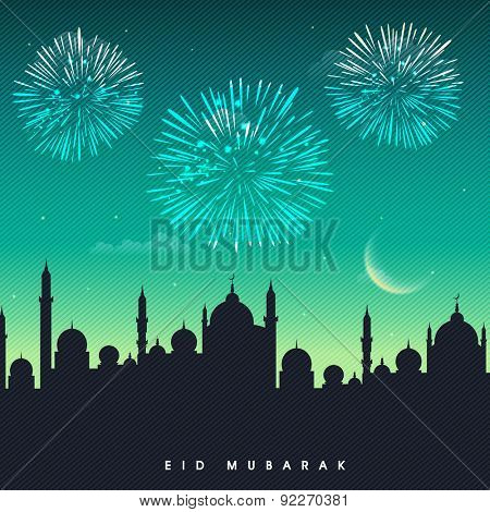 Muslim community festival, Eid Mubarak celebration with mosque silhouette on fireworks decorated night background.