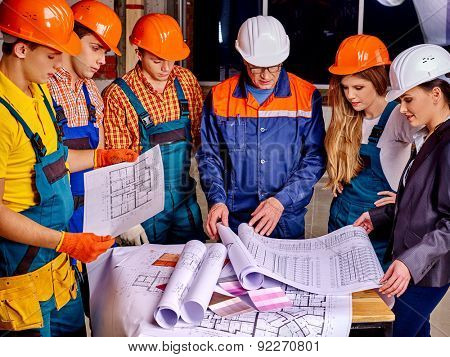 Business group people in builder helmet indoor.