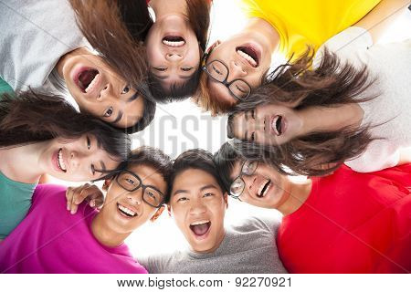 Group Of Happy  Young Student  With Arms Around